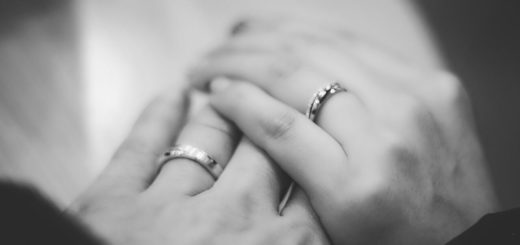 Two hands with wedding rings