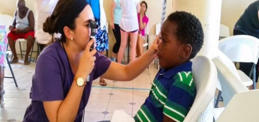 Child receiving an eye exam in Belize
