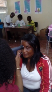 Woman getting eye exam in Jamaica