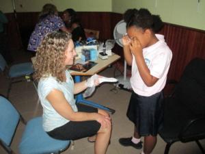Little girl getting glasses in Sint Maarten
