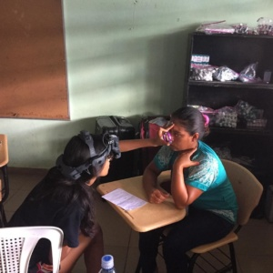 Woman getting eye exam in Panama