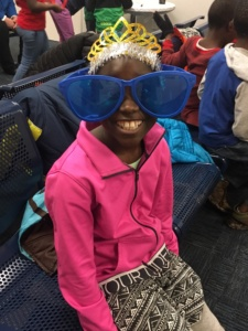 Little girl with sunglasses from the African Children's Choir