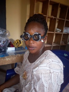 Woman getting an eye exam in Nigeria