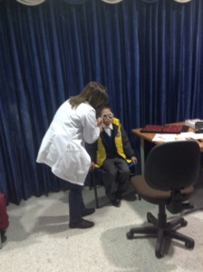 Child receiving eye exam in Bogota, Colombia