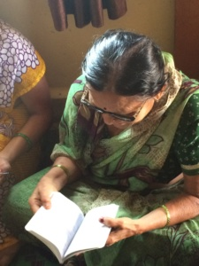 Woman reading the bible in India