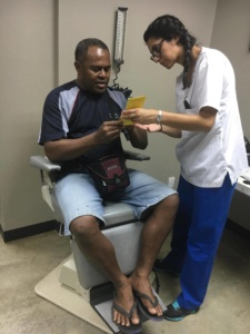 Man getting eye exam in Fiji