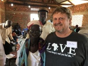 Helper Mike with woman in Uganda