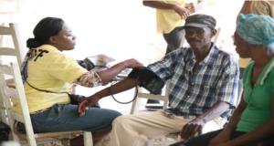 Nurse with local Haitians